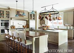 Two islands and double ovens are necessary for homeowners who are avid entertainers and hosts to many out-of-town guests. - Photo: Erica Dines / Design: Barbara Westbrook