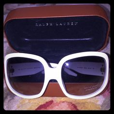 Ralph Lauren White Sunglasses Brand New Has the small label on lease still but no actual price tag attached. These are brand new and come with the tan hard case. Ralph Lauren Accessories Sunglasses