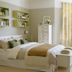 I love the color and design of this bedroom. Especially the shelves above the bed.