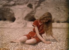 Autochrome of Christina O'Gorman, photographed by her father, Mervyn, in 1913. She is at the beach in Dorset, England.