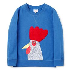 100% Cotton French Terry Sweater. 2x2 rib trims. Features rosster placement print with chenille applique on front panel. Regular fitting silhouette. Available in Petrol Blue.