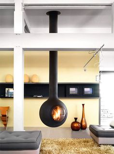 Hanging fireplace design and construction, including modern suspended designs are available through Focus and CFD. Custom Fireplace, Modern Fireplace, Fireplace Design, Suspended Fireplace, Hanging Fireplace, Focus Fireplaces, Contemporary Decor, Contemporary Fireplaces, Kugel