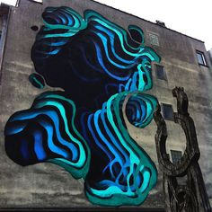 Street Artist Spray-Paints Stunning Optical Illusion Murals That Look Like 3D Portals