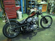 olive green evo big twin softail custom with quilted king cobra seat and broomstick risers by Shix Customs Softail Bobber, Harley Bobber, Harley Davidson Chopper, Bobber Chopper, Old School Chopper, Drag Bike, Old Motorcycles, Kustom Kulture, Hot Bikes