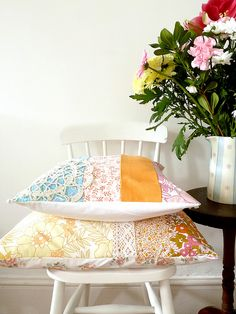 the pillows with their little bits of lace and vintage fabrics... yummy!