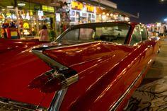 Red Car - Red 1950's Cadillac in the Bangkok Train Market (ตลาดรถไฟ)  See more at http://www.bangkok-travel-ideas.com/talad-rot-fai.html