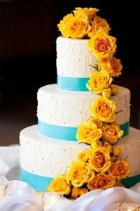 Teal and Yellow Wedding Cake. Love, but I want Sunflowers not roses.