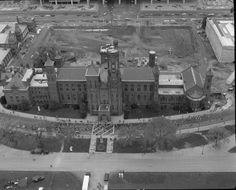 1982: An aerial view of the Smithsonian Castle, in front of the early construction site for the future @nmafa and @Freer|Sackler buildings #africanartat50 #tbt #africa
