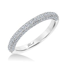 Classic diamond accented wedding band available in 18kt gold or platinum.