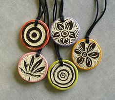 Ceramic pendants were individually carved with the tiniest little loop tool