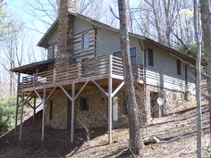 This gorgeous mountain log cabin is constructed with the antique-style logs and boasts 2 bedrooms, a loft sleeping area, and 3 full bathrooms. The main level features a great room with a floor to ceiling stone fireplace, wide pine plank floors, and a rustic staircase. An open floor plan will keep everyone cozy and engaged!  For more info, go to www.ashecountyrealestate.com and search for F134