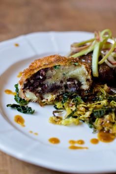 Black pudding croquette with pigs cheek and pickled rhubarb from Kitchen 72