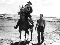 THE SEARCHERS - Jeffrey Hunter walks beside John Wayne who is carrying Natalie Wood - Based on novel by Alan LeMay - Directed by John Ford - Warner Bros. Movie Plot, Film Movie, Iowa, Warner Bros Movies, Jeffrey Hunter, Harry Carey, John Wayne Movies, The Searchers, Film Pictures