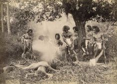 Fijian men posed preparing for a cannibal banquet Between 1885 and 1891