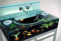 Aquarium sink. That is just too clever for anyone's good. Ooh! Aquarium BATHTUB!!