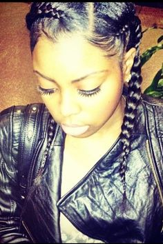 "A Sexy spin on the regular ""two french braids"" that many of us grew up with. By simply parting the hair at an angle (vs. down the middle,) will offer a modern edge that is SHARP! This is a great protective style to boot! Don't forget to smooth those edges at a curve ladies! :-)"