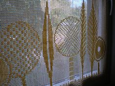 A different kind of crocheted curtain.