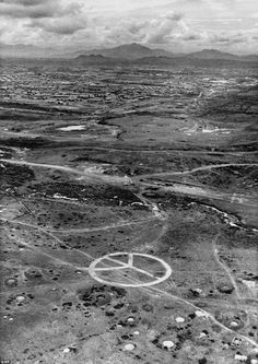 In the northern part of South Vietnam an aerial image shows a large peace sign–apparently gouged out of the countryside with a bulldozer–near Camp Eagle, headquarters of the 101st Airborne Division. May 8, 1971