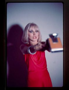 Debbie Harry take a polaroid of herself. Photo by Chris Stein.