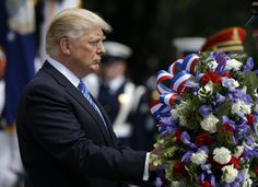 President Trump marked his first Memorial Day as commander-in-chief Monday, placing a wreath at the Tomb of the Unknown Soldier at Arlington National Cemetery and later laying flowers at the grave of the son of Homeland Security Secretary John F. Kelly.