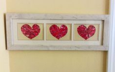 Valentines Day Crafts: Upcycled frame and scrapbook paper cost less than 2 bucks to make this! One of our volunteers did this for Christmas! Looks so pretty