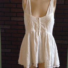"Free people eyelet tank Super cute. Corset clips at top. Double layered I do not trade length from bottom of the armpit is about 19"" from back of neck to bottom hem is about 25"" Free People Tops Tank Tops"