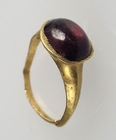 Date: 7th century Geography: Made in Northern France Culture: Frankish Medium: Gold, garnet cabochon Dimensions: Overall: 3/4 x 5/8 x 3/8 in. (1.9 x 1.6 x 0.9 cm) bezel: 3/8 x 5/16 x 3/16 in. (1 x 0.8 x 0.5 cm) Classification: Metalwork-Gold