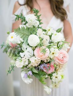 whimsical white and pink bouquet featuring ranunculus, sweet peas and ferns by Moon Canyon