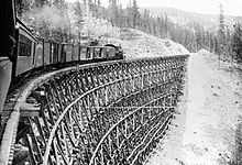 Train on the Kettle Valley Railway crossing trestle at Sirnach Creek, 1916. BC Canada