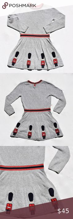 Mini Boden Knitted Royal Guards Dress Mini Boden Knitted Royal Guards Dress   Gray cotton sweater dress with red and navy embellishments and small embroidered royal guards.  Excellent Used Condition   Perfect for imaginative kids- inspired by Roald Dahl books! Mini Boden Dresses Roald Dahl Books, Kids Inspire, Royal Guard, Boden Dresses, Mini Boden, Cotton Sweater, Gray Dress, Cheer Skirts, Embellishments