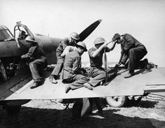 Armourers of No 32 Squadron RAF replenish the ammunition in the starboard wing magazine of Hurricane Mk I GZ-H at RAF Hawkinge on 29 July 1940. Pilots quickly realised that the harmonisation of their Browning Mk II machine guns was way out at 400yds convergence, as they were having to get much closer to their targets to ensure critical hits were achieved. The plumbers were, therefore, instructed to toe in the guns to a harmonisation distance of just 120yds.