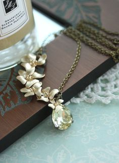 A Cascading Orchid Flower Yellow Jonquil Glass Jewel.  The orchid necklace a gift from her brother