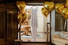 Foil balloons are available in a variety of shapes and sizes and are great as fun photo props. #weddingdecor #balloons #gold