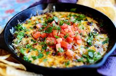 "Queso Fundido by thepioneerwoman: Queso Fundido"" translates to ""molten cheese"" (or ""melted cheese"") and this skillet of wonderfulness definitely has plenty to spare! Serve it with tortillas or chips or both."