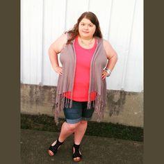 Cute plus size fashion outfit. Fringe vest, coral tank top, denim shorts, black sandals.