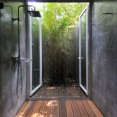 Bathroom atrium. Really letting the outdoors in- but with privacy!