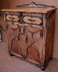 amazing how much of our furniture has been pinned with no credit to Westwink...adirondack style cabinet..love the tramp art edging