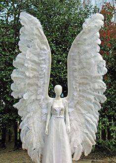 Archangel costume wings tower over this 6 foot tall mannequin