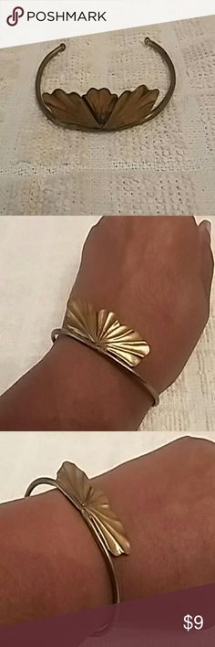 Vintage brass bangle Dainty copper and brass bangle with leaf motif. Vintage 1970s. Very good condition but some tarnish. Copper leaves soldered to brass wristband. Jewelry Bracelets