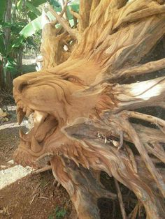 New post on viralthings Chainsaw Wood Carving, Wood Carving Faces, Tree Carving, Wood Carving Art, Yard Sculptures, Tree Sculpture, Hand Carved Walking Sticks, Scary Art, Cat Art Print
