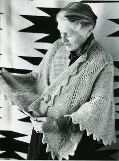 Elizabeth Zimmerman wearing the 'Sawtooth Bordered Pi Are Square Shawl'.    Pattern found in her book 'Knitting Around' pages 111-117.   Pattern also found at Schoolhouse Press....