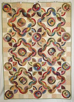 Love the setting for this bulls eye quilt. It should work for Drunkards Path or other quilts of that nature too.