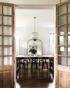 This stunning dining room design is anchored by Vintage French Door Pair. Photo shared by on of our amazing customers! Vintage Doors, Antique Doors, Front Door Entryway, Giant Mirror, Reclaimed Doors, English House, Next At Home, Dining Room Design, French Doors