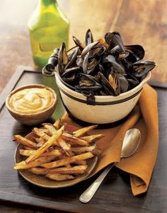 moules - frites. Classic Belgian dish. --Hmm, I've never had mussels before, but I'd try it once.