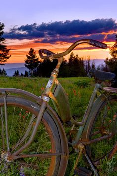 """Vail Valley Sunset by Todd Van Fleet - No bike should spend its life on the sidewalk. That's why Todd Van Fleet rescues bikes, """"Snapping the shutter is the easy part. Finding the bikes is where the real adventure begins."""" Toddrescues old cruiser bikes from the corners of barns, sheds, and attics; then straps them to his back and hikes to far-flung, lonely landscapes giving each bike a story in a photo. ...Click any image and read more and see more. Tags: bike,bikes,cycling,bicycling,riding,"""