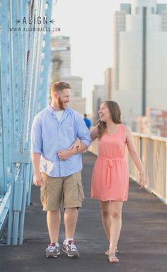 Engagement photos in downtown Cincinnati on the Roebling Bridge. Photography by Align Images. www.alignimages.com