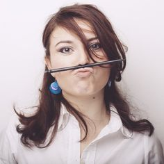 Blogger With Pencil On Mouth