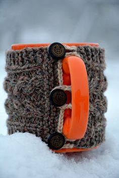 Knitted cup hug mug helps to keep your hot drink warm longer and you can hold the cup without burning your hands. The cup sleeve has three black