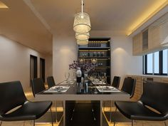 Solid Black Dining Chairs With Black Glass Dining Table Under Triple Pendulum Lit High Contrast Dining China