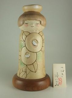 Tsubaki camellia Kokeshi doll. I haven't seen one carved quite like t his before.